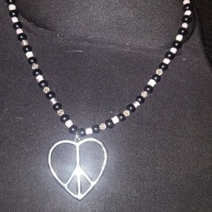 Black/pink beaded necklace w/ heart/peace Pendant
